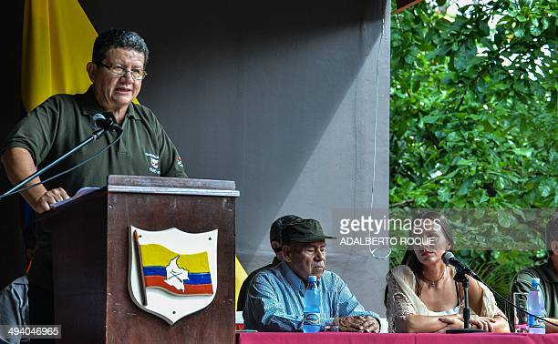 The cofounder of the Revolutionary Armed Forces of Colombia commander Miguel Pascuas and guerrilla fighter Tanja Nijmeijer listen to commander Pablo...