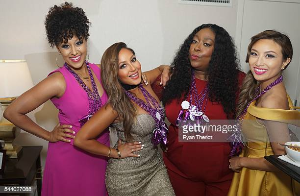 The cohosts of 'The Real' Tamera MowryHousley Adrienne Bailon Loni Love and Jeannie Mai get ready to kick off their New Orleans visit with a bead...