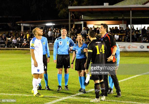 The Coin toss before the FFA Cup round of 16 match between Moreton Bay United and Gold Coast City at Wolter Park on August 23 2017 in Brisbane...