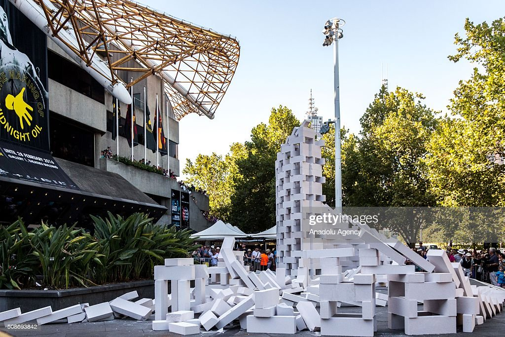 The collapse collection of dominoes during the Arts Centre Melbournes Dominoes arts project in Melbourne, Australia, on February 6, 2016. More than 7000 giant dominoes snaked through Melbourne city over 2km.