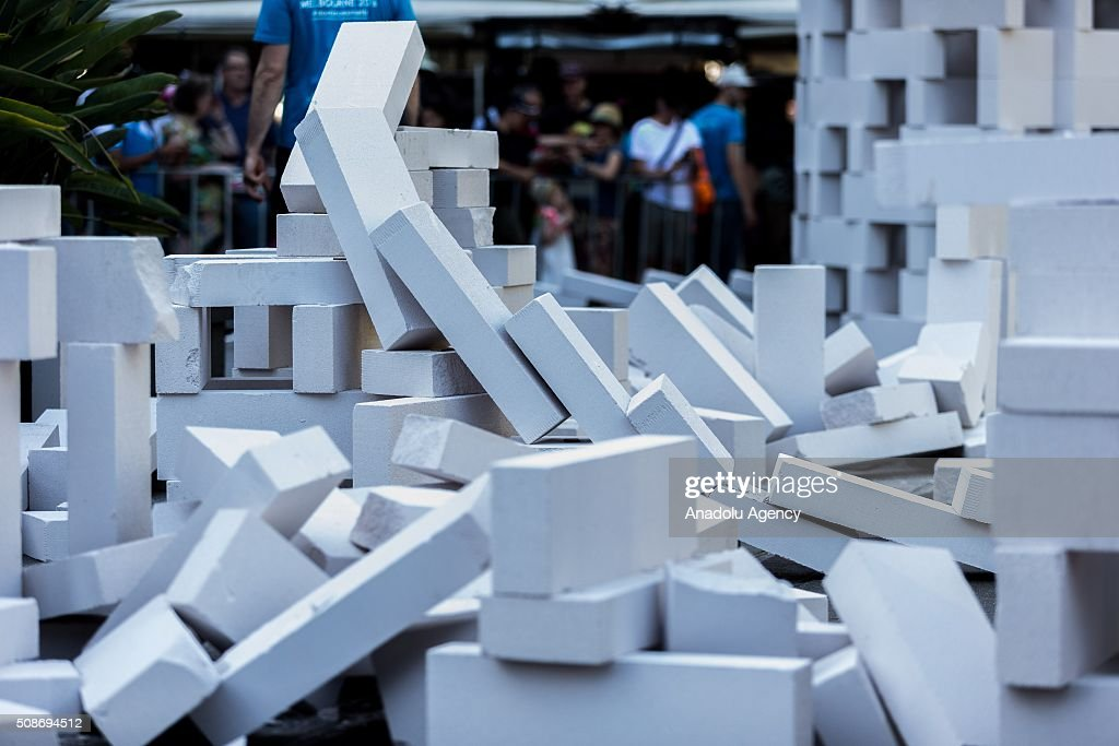 The collapse collection of dominoes during the Arts Centre Melbournes Dominoes arts project in Melbourne, Australia February 6, 2016. More than 7000 giant dominoes snaked through Melbourne city over 2km.
