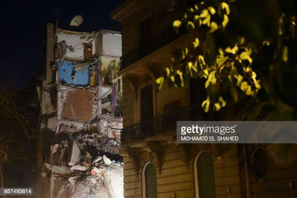 TOPSHOT The collapsed building is seen in Garden City area downtown Cairo on March 25 2017 / AFP PHOTO / MOHAMED ELSHAHED