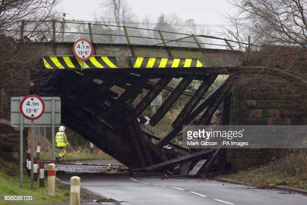 The collapsed railway bridge at the scene of an 'intensive' blaze after a freight train carrying fuel derailed and caught fire near Stewarton in...