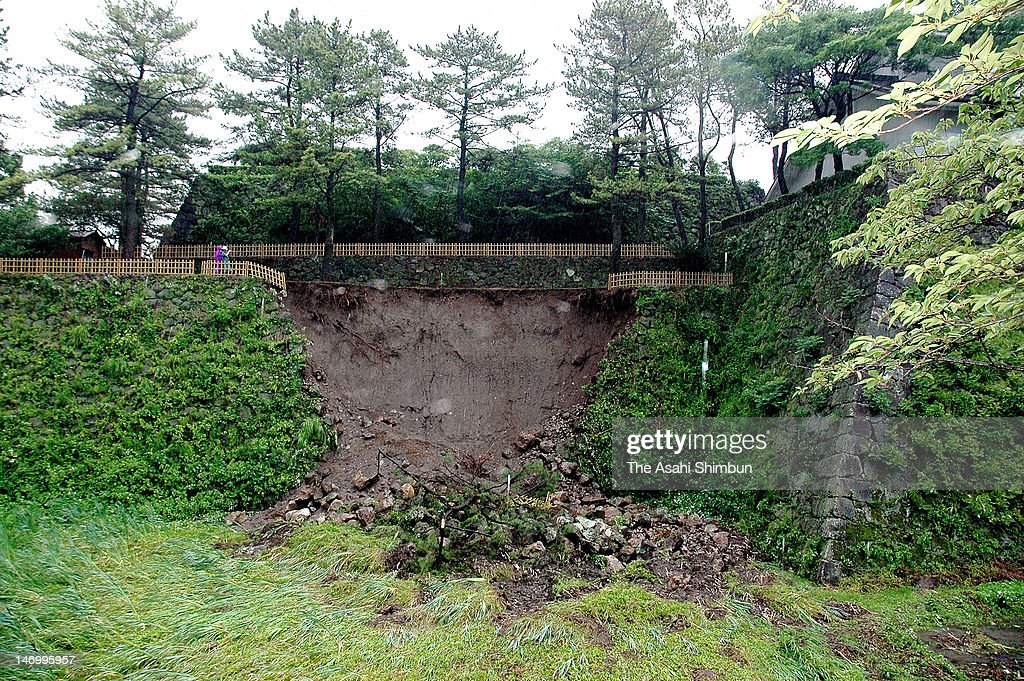 The collapsed stone wall of Shimabara Castle is seen on June 24, 2012 in Shimabara, Nagasaki, Japan. 300 milimeters of rainfall in 24 hours were recorded in various places because of the rain front remains over Kyushu Island, causes landslides and evacuation advisory.