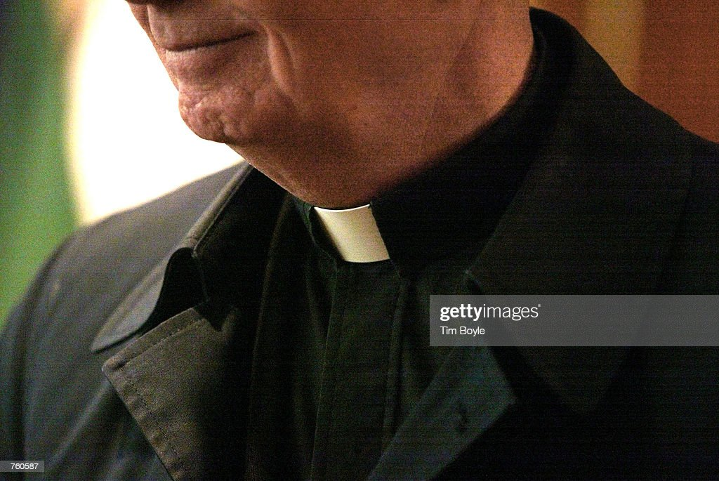The collar of a priest is seen at St Adalbert Catholic Church March 29 2002 in Chicago IL Good Friday's 'Way of the Cross' services is celebrated by...