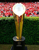 The College Football Playoff National Championship Trophy is seen on the field prior to the game between the Georgia Bulldogs and the Tennessee...