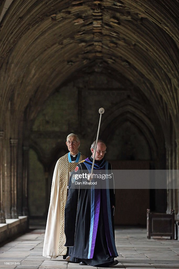 The College of Canons including the Very Reverend Dr Robert Willis (rear) are led through the cloisters to the Chapter House ahead of the formal election of Justin Welby as the new Archbishop of Canterbury, on January 10, 2013 in Canterbury, England. The College of Canons met today inside the 14th century Chapter House at Canterbury Cathedral to elect the new Archbishop after receiving the 'Conge d' Elire' and 'Letter Missive' from the Crown authorising the election to take place. Welby, currently the Bishop of Durham, will take over from Dr Rowan Williams, the 104th Archbishop of Canterbury, who stepped down from the position on December 31, 2012.