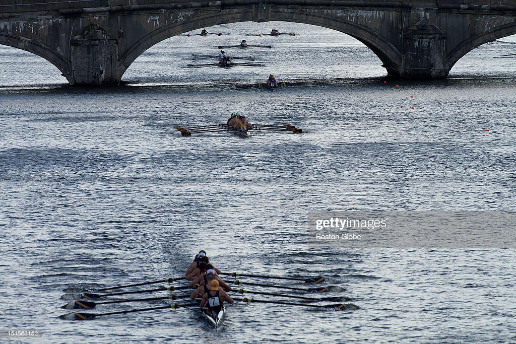 The Collegiate Men's Eights rowing crews make their way down the river during the Head of the Charles Regatta from the river's side on Sunday morning, October 21, 2012.
