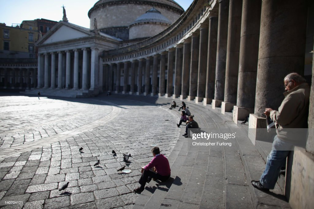The collonades of San Francesco Di Paolo church in Piazza Plebiscito on November 14, 2011 in Naples, Italy. Naples is famed for it's narrow streets, pizza, Mount Vesuvius and Unesco protected buildings.
