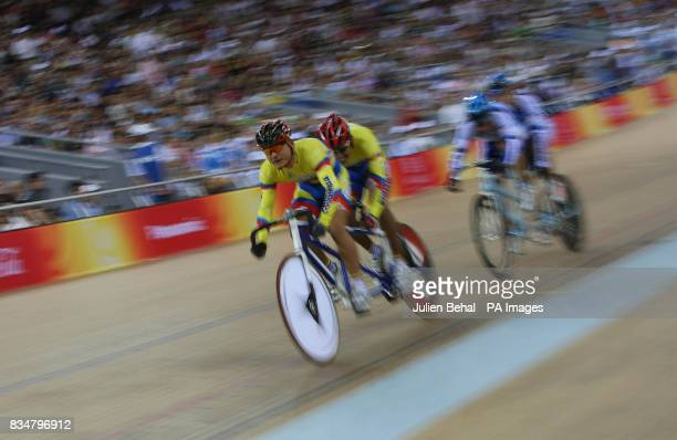 The Colombian mens sprint team pull ahead of Argentina in a battle over 5th and 6th place in the men's sprint BVI in the Laoshan Velodrome at the...