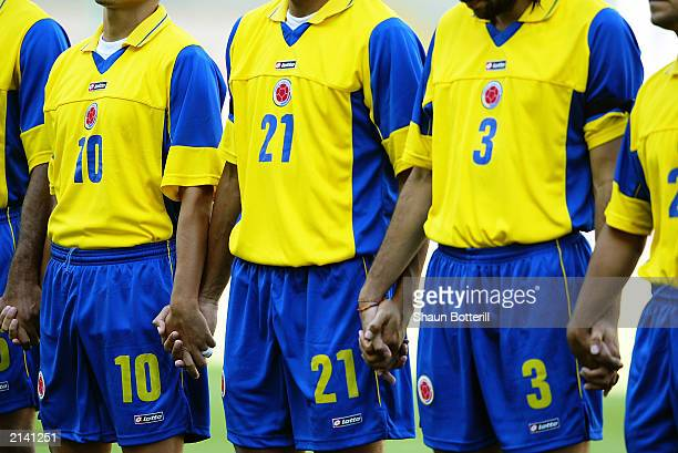 The Colombian players hold hands while observing the minutes silence in honour of Cameroon player MarcVivien Foe who tragically died on the pitch in...