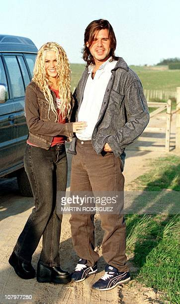 The Colombian singer Shakira poses next to his fiance Antonio de la Rua son of Argentine President Fernando de la Rua in La Barra de Maldonado...