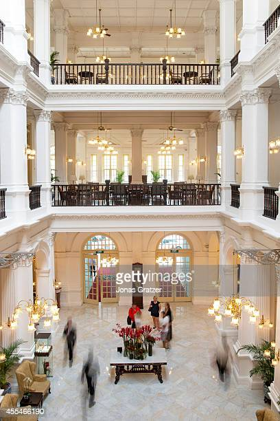 The colonial style lobby from the second floor walkway of the Raffles Hotel