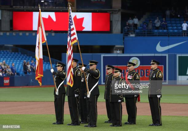 The Color Guard holds Canadian and American flags on the field during the playing of the Canadian national anthem on the sixteenth anniversary of...