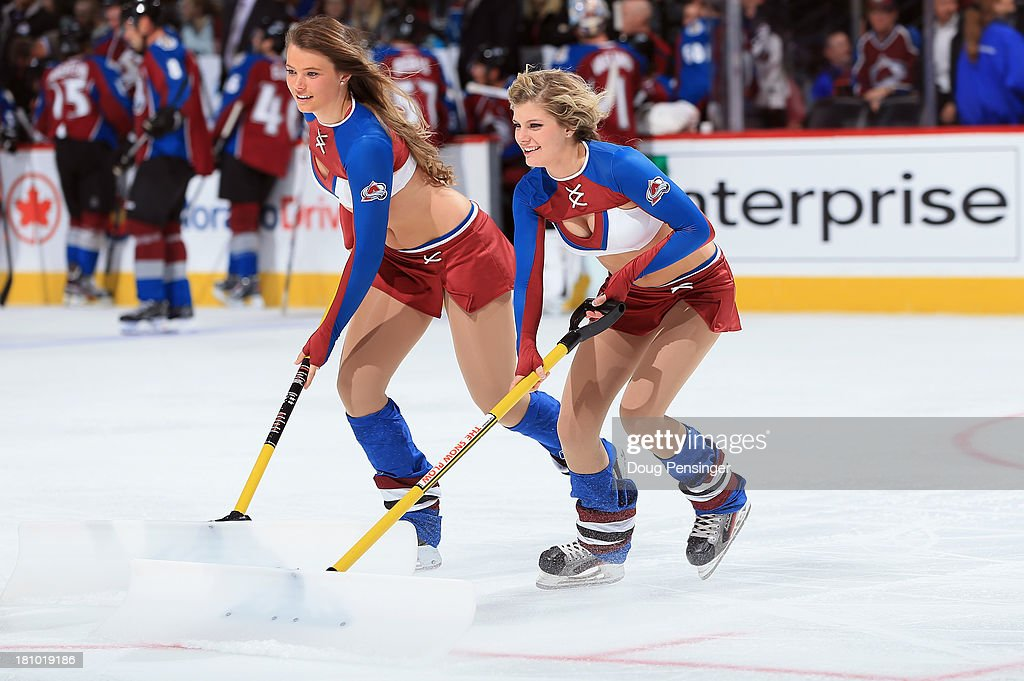 The Colorado Avalanche ice girls clean the ice during a break in the action against the Anaheim Ducks during preseason action at Pepsi Center on September 18, 2013 in Denver, Colorado. The Ducks defeated the Avalanche 2-1.