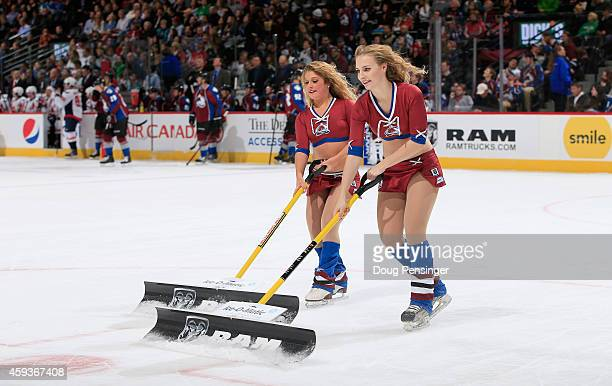 The Colorado Avalanche Ice Girls clean the ice during a break in the action against the Washington Capitals at Pepsi Center on November 20 2014 in...