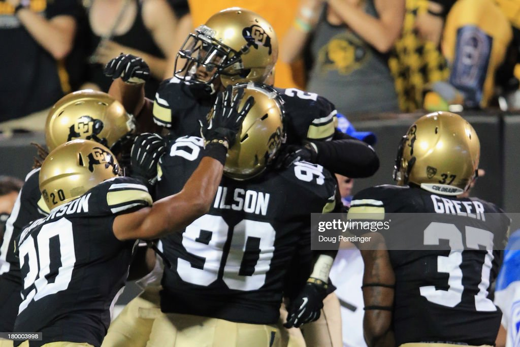 The Colorado Buffaloes celebrate after defensive back Kenneth Crawley #2 of the Colorado Buffaloes intercepted a pass by quarterback Wynrick Smothers #4 of the Central Arkansas Bears in the endzone late in the fourth quarter at Folsom Field on September 7, 2013 in Boulder, Colorado. The Buffaloes defeated the Bears 38-24.