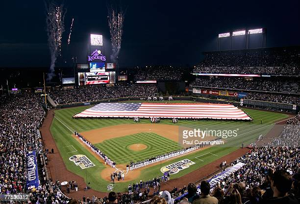 The Colorado Rockies and the Boston Red Sox line up for the singing of the National Anthem before the start of Game Three of the 2007 World Series at...