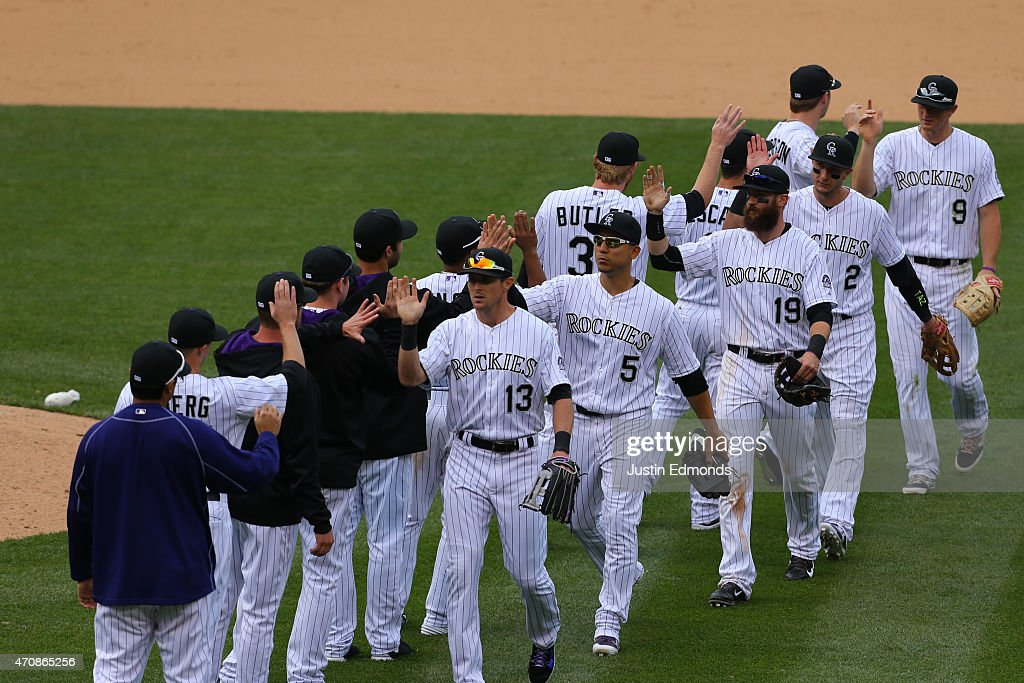 The Colorado Rockies celebrate a 2-1 win against the San Diego Padres at Coors Field on April 23, 2015 in Denver, Colorado.