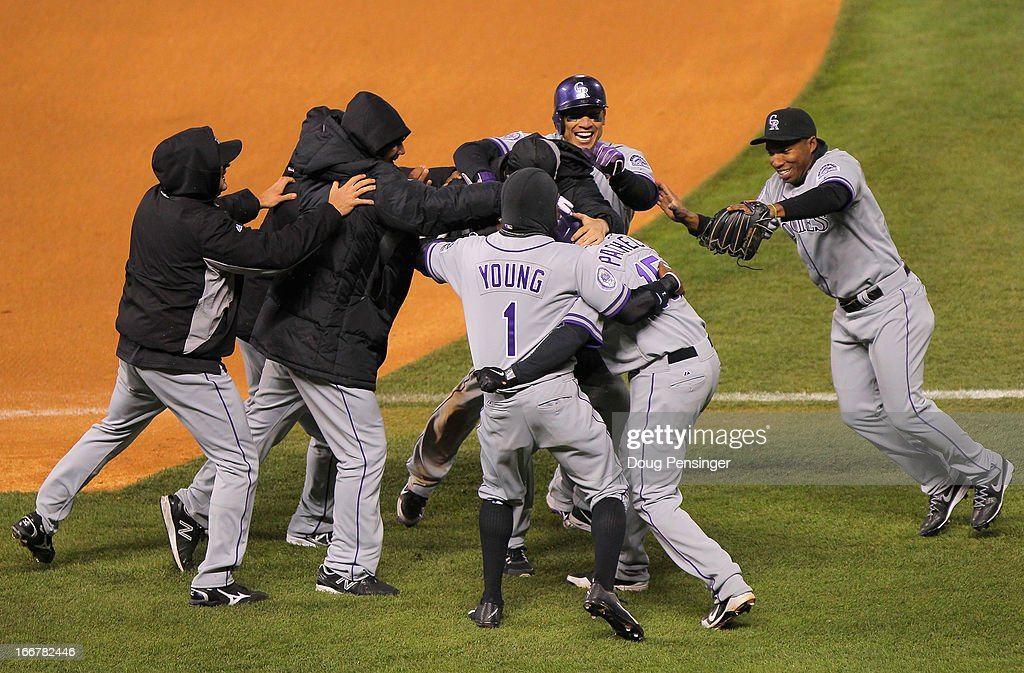 The Colorado Rockies celebrate after <a gi-track='captionPersonalityLinkClicked' href=/galleries/search?phrase=Jordan+Pacheco&family=editorial&specificpeople=6889136 ng-click='$event.stopPropagation()'>Jordan Pacheco</a> #15 of the Colorado Rockies hit the game winning RBI single to score Carlos Gonzalez #5 of the Colorado Rockies and defeat the New York Mets 9-8 in the 10th inning at Coors Field on April 16, 2013 in Denver, Colorado.