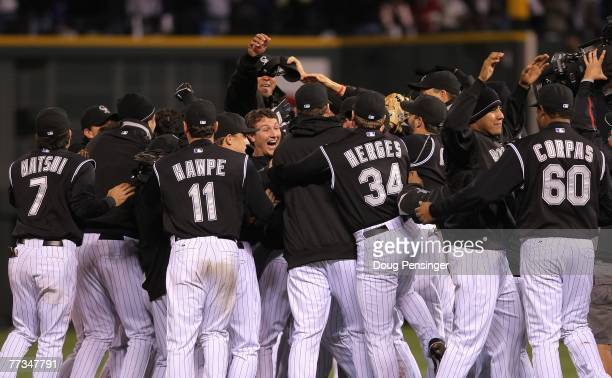 The Colorado Rockies celebrate their 64 victory to advance to the World series against the Arizona Diamondbacks during Game Four of the National...