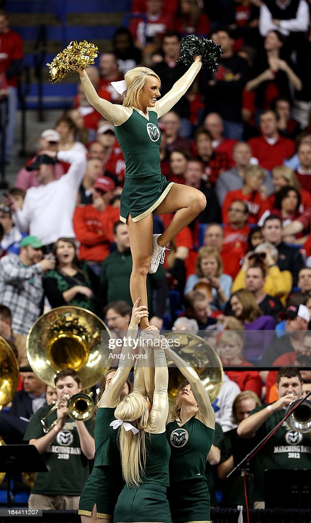 The Colorado State Rams cheerleaders perform during a game stoppage in the first half against the Louisville Cardinals during the third round of the 2013 NCAA Men's Basketball Tournament at Rupp Arena on March 23, 2013 in Lexington, Kentucky.