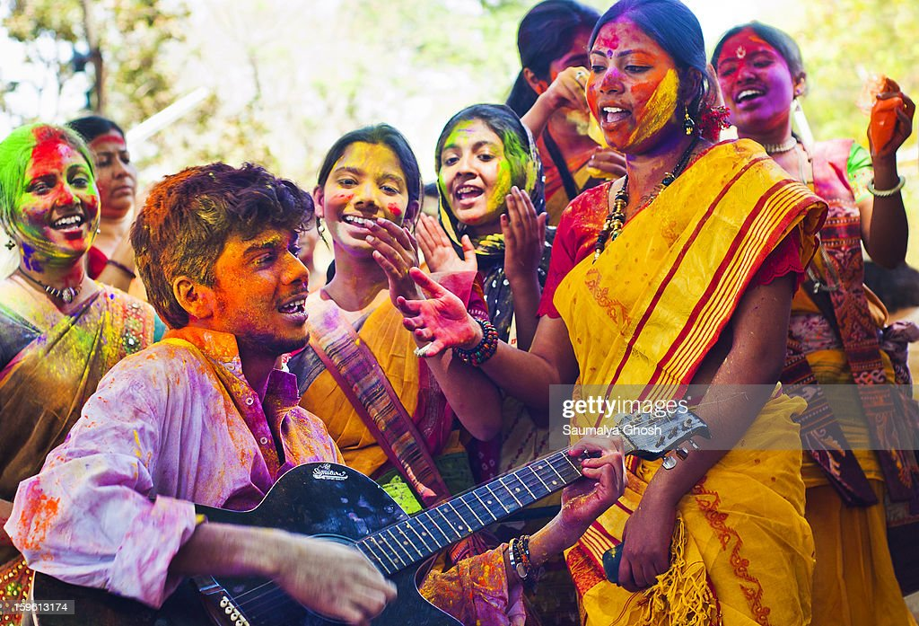 CONTENT] The colorful festival of Holi is celebrated on Phalgun Purnima which comes in February end or early March. Holi festival has an ancient origin and celebrates the triumph of 'good' over 'bad'. The colorful festival bridges the social gap and renew sweet relationships. A group of college students are singing together and enjoing the auspicious day in full bloom.