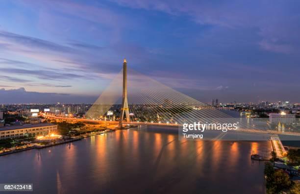 The colorful sunset cityscape of Rama 8 Bridge. Bangkok Thailand