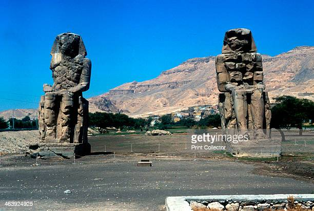 The Colossi of Memnon near the Valley of the Kings Egypt 14th century BC These two 70ft/21m stone statues of Amenhotep III stood in front of the...