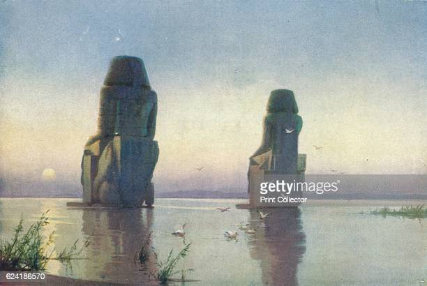 The Colossi of Thebes Moonrise' c1880 From Egypt by R Talbot Kelly [Adam Charles Black London 1904] Artist Robert George Talbot Kelly
