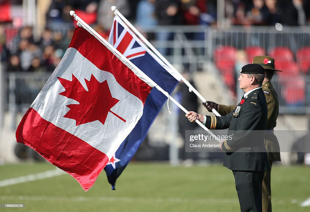 The colour guard stand at attention during the anthems prior to the New Zealand Maori All Blacks playing against Team Canada during the AIG Canada exhibition game at BMO Field on November 3, 2013 in Toronto, Ontario, Canada. The Maori All Blacks defeated Team Canada 40-15.