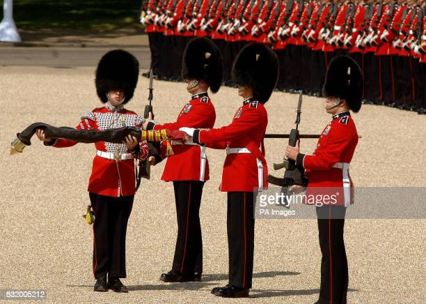 The Colour is unsheathed before the start of the Trooping the Colour Ceremony on Horse Guards parade ground in Central London PRESS ASSOCIATION Photo...
