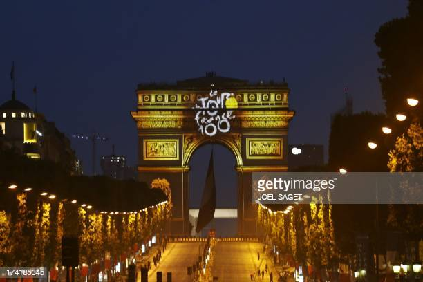 The colour of Tour de France winner yellow jersey is projected on Paris' landmark Arc de Triomphe on the Champsp Elysees avenue after the end of the...