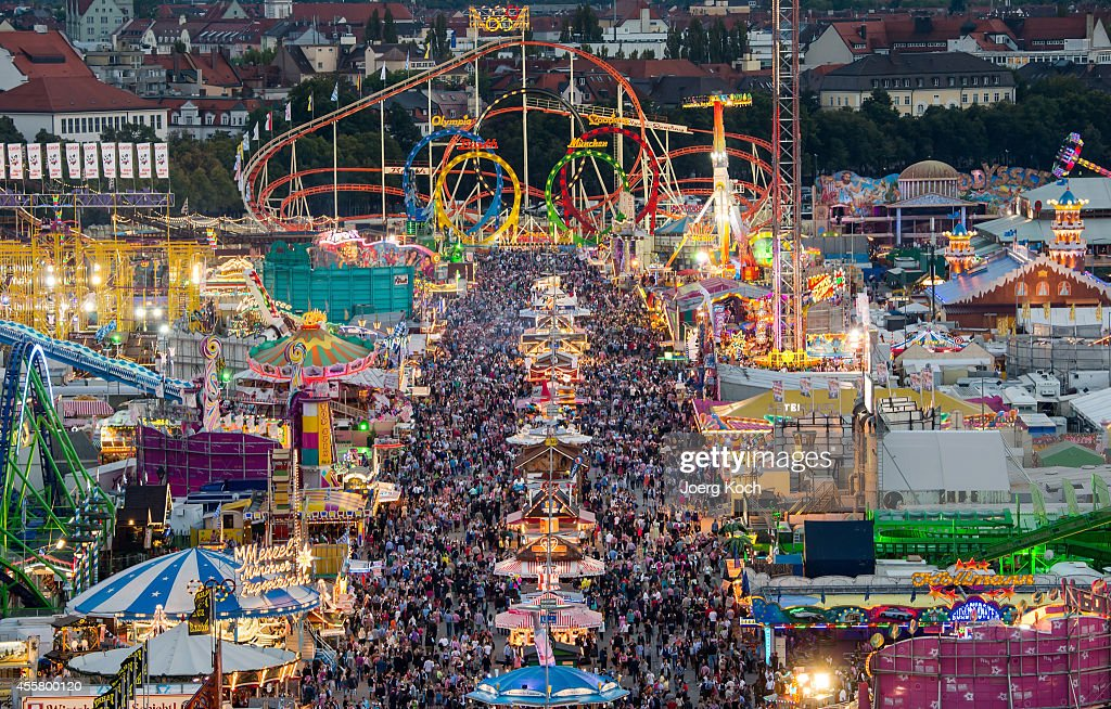 The colourful lights of the Oktoberfest begin to shine during sunset at the opening day of the 2014 Oktoberfest on September 20 2014 in Munich...