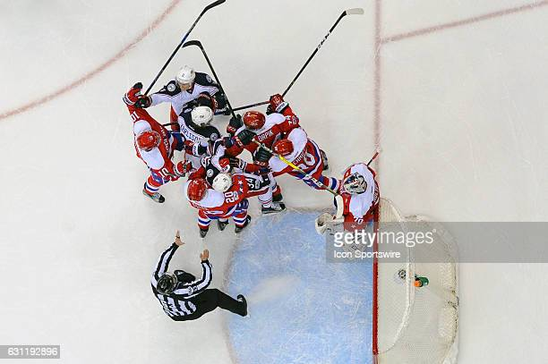 The Columbus Blue Jackets and the Washington Capitals mix it up in the first period in front of the net on January 5 at the Verizon Center in...