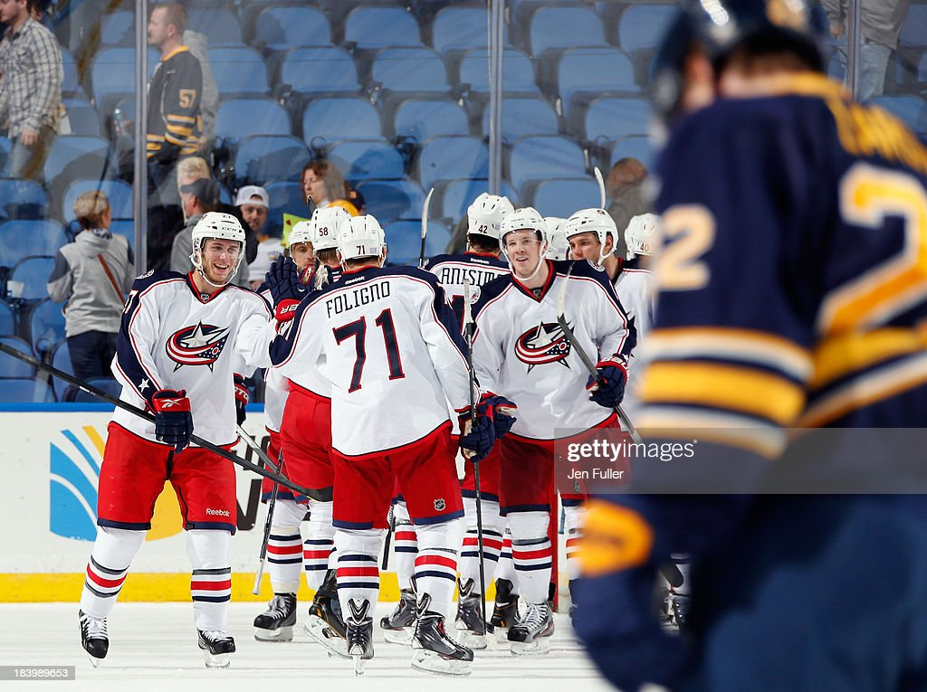 The Columbus Blue Jackets celebrate a 4-1 victory over the Buffalo Sabres at First Niagara Center on October 10, 2013 in Buffalo, New York.