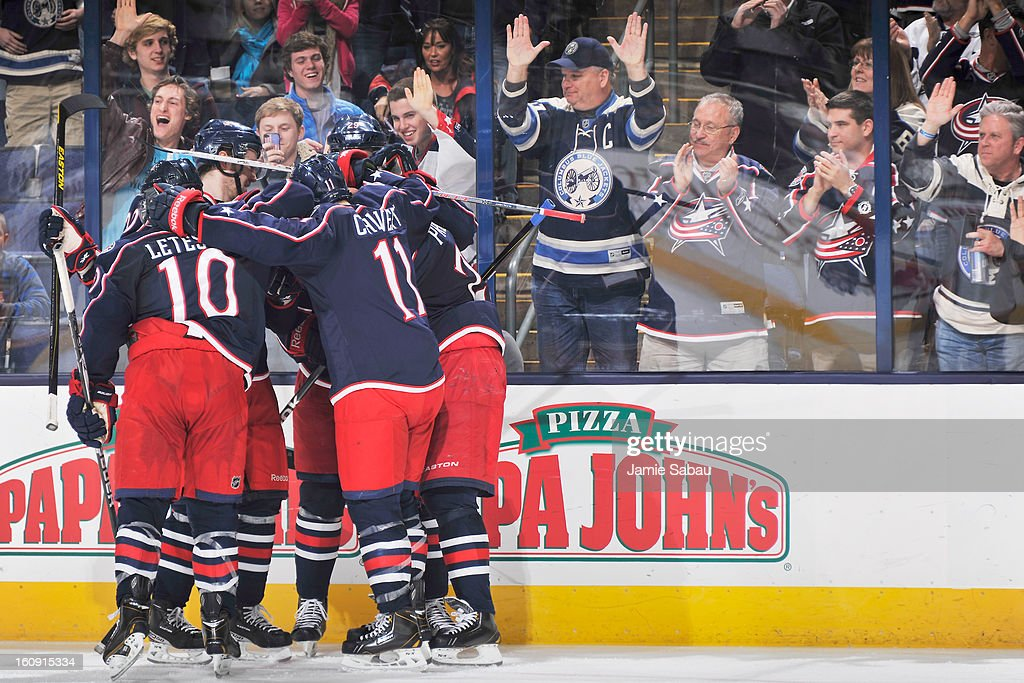 The Columbus Blue Jackets celebrate a third period goal by Vinny Prospal #22 of the Columbus Blue Jackets against the Calgary Flames on February 7, 2013 at Nationwide Arena in Columbus, Ohio. Calgary defeated Columbus in overtime 4-3.