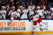 The Columbus Blue Jackets celebrate after defeating the New York Islanders in a shootout at Nassau Veterans Memorial Coliseum on April 11 2015 in...