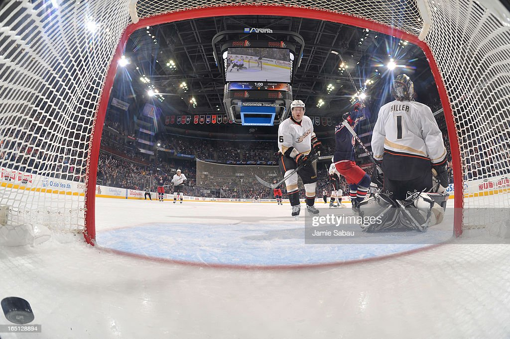 The Columbus Blue Jackets celebrate an overtime goal against <a gi-track='captionPersonalityLinkClicked' href=/galleries/search?phrase=Jonas+Hiller&family=editorial&specificpeople=743364 ng-click='$event.stopPropagation()'>Jonas Hiller</a> #1 of the Anaheim Ducks on March 31, 2013 at Nationwide Arena in Columbus, Ohio. Columbus defeated Anaheim 2-1 in overtime.