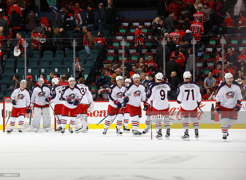 The Columbus Blue Jackets celebrate on ice after a win against the Calgary Flames at Scotiabank Saddledome on February 5, 2016 in Calgary, Alberta, Canada.