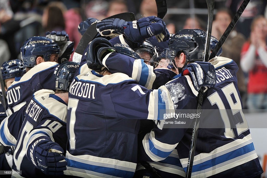 The Columbus Blue Jackets celebrate their overtime win against the Vancouver Canucks on March 7, 2013 at Nationwide Arena in Columbus, Ohio. Columbus defeated Vancouver 2-1 in overtime.