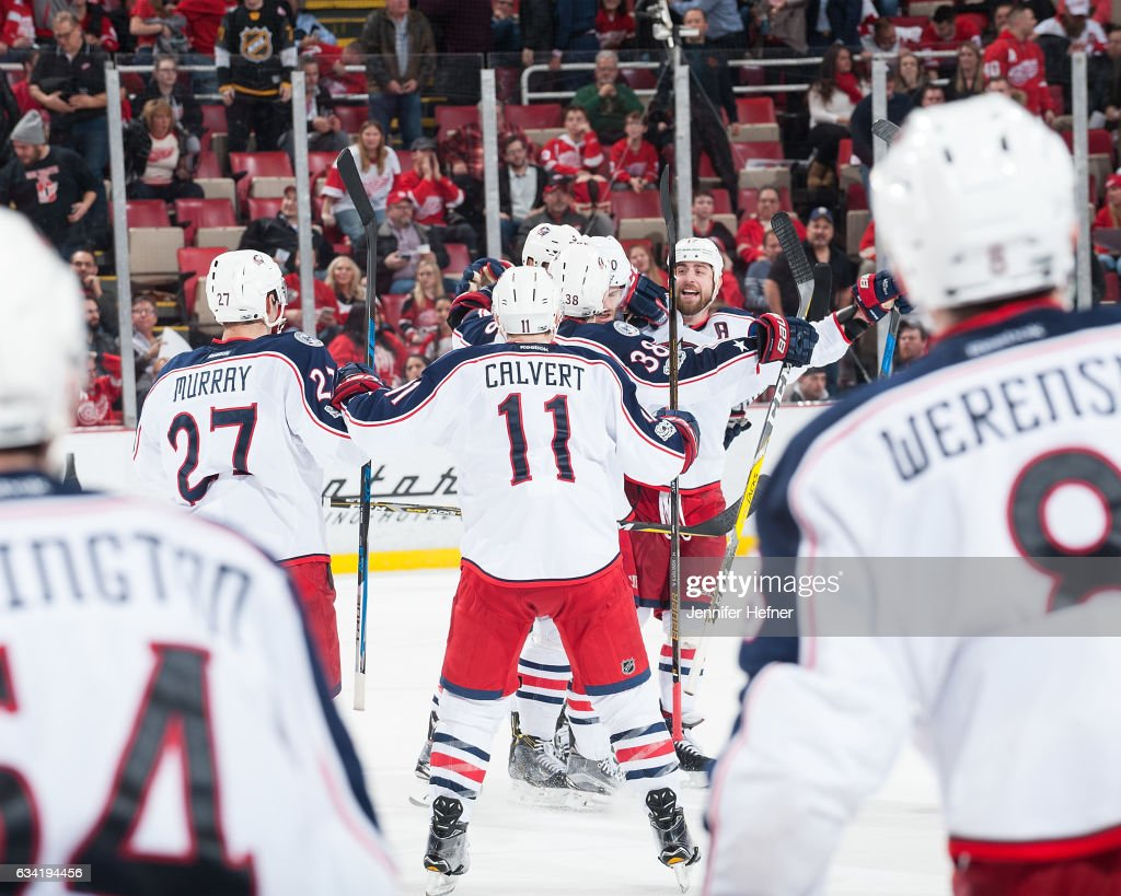 The Columbus Blue Jackets players all skate out to congratulate teammate Seth Jones #3 after he scores the game winning goal in overtime during an NHL game against the Detroit Red Wings at Joe Louis Arena on February 7, 2017 in Detroit, Michigan. The Blue Jackets defeated the Wings 3-2 in OT.