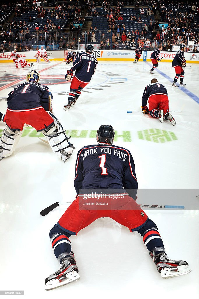 The Columbus Blue Jackets stretch on the ice wearing a special jersey for the fans before their home opener against the Detroit Red Wings on January 21, 2013 at Nationwide Arena in Columbus, Ohio.