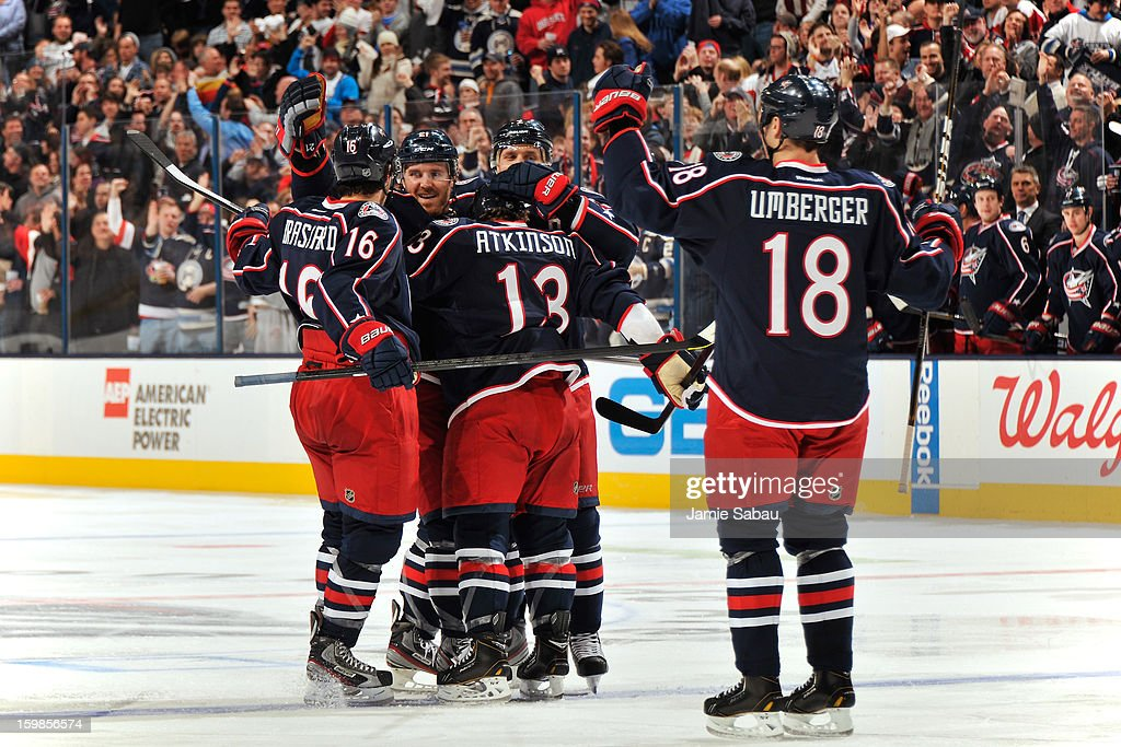 The Columbus Blue Jackets surround and celebrate with <a gi-track='captionPersonalityLinkClicked' href=/galleries/search?phrase=James+Wisniewski&family=editorial&specificpeople=688111 ng-click='$event.stopPropagation()'>James Wisniewski</a> #21 after he scored a power play goal in the third period against the Detroit Red Wings on January 21, 2013 at Nationwide Arena in Columbus, Ohio. Detroit defeated Columbus 4-3 in a shootout.