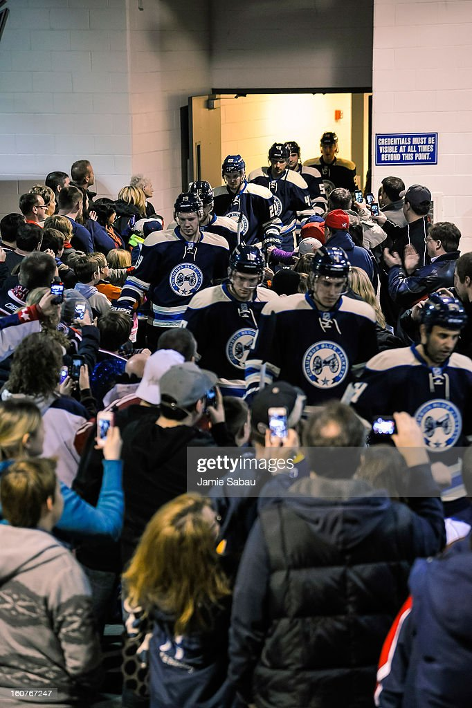 The Columbus Blue Jackets take the ice for a game against the Detroit Red Wings through a tunnel of pride made up of their fans on February 2, 2013 at Nationwide Arena in Columbus, Ohio.