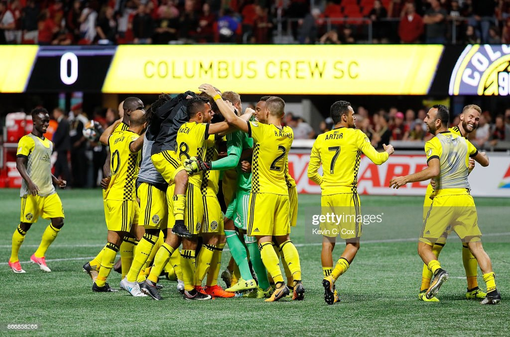 The Columbus Crew celebrates after Adam Jahn #12 converts a penalty kick to give the Crew a win over the Atlanta United 3-1 on penalties during the Eastern Conference knockout round at Mercedes-Benz Stadium on October 26, 2017 in Atlanta, Georgia.