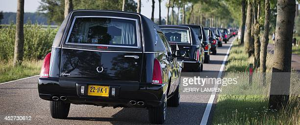 The column of funeral hearses drive near Nieuwegein after leaving the airbase in Eindhoven to Hilversum on July 26 on the fourth day of the airlift...