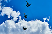 The combat link is the Russian tactical front-line bomber in the blue sky above the Crimea. Silhouettes of airplanes bottom view.