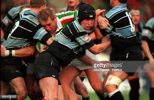 The combined efforts of Glasgow's David McLeish Fraser Scott and Ian Jardine aren't enough to prevent Dean Richards of Leicester from scoring a try