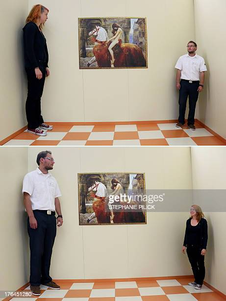 The combo of two pictures shows Katrin Klingenberg and Sascha Koehler employees at the exhibition 'Wanderings about the Senses' demonstrating an...